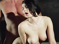 A raven haired pale girl with natural tits is fucked from behind