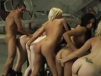 Crazy gangbang fuck party in the hangar with some hot babes