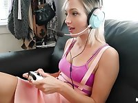 Teen Eliza Jane is playing video games while BF finger fucks her pussy