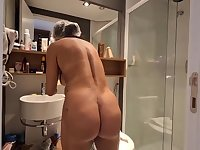 Brazilian dark haired with large, hard hooters, Bianca Naldy is getting banged from the back, in the shower