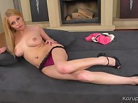 High heeled solo blonde babe plays with her naked pussy