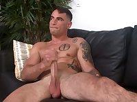 Tattooed guy enjoys jerking his hard pecker until he cums