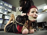 Submissive secretary gets caught and tied up in the office