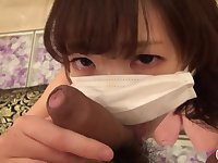Japanese uncensored: young Asian in antiflue mask sucking cock