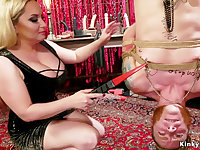 Heavy-Breasted domme clamps one-eyed snake to slave