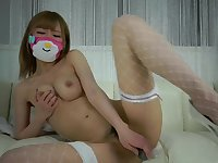 Petite Asian girl in white stockings masturbates with vibrators