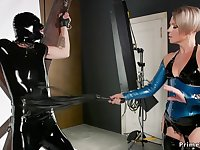Mom domme whips male in latex suit