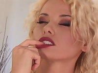 Solo blonde porn star MILF Caylian Curtis masturbates in high heels