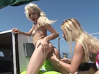 Tight blonde teen lesbians Elsa Jean and Marsha May have fun on a boat
