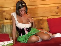 Curvy solo brunette model masturbates in a sauna with toys