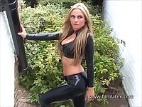 Blonde latex babe Amandas outdoor high heel boots and tight rubber-latex fetish wear on sexy fetish wear loving beauty in solo softcore posing