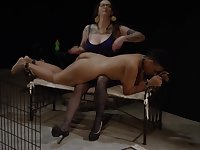 Lesbian ebony slave let out of the cage to get spanked and fingered