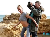 Blonde MILF outdoor sex near the sea on a windy day