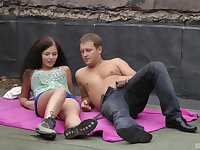 Curly haired brunette teen Angel Dickens rides cock in public