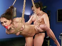 Lesbian submission in scenes of rough femdom