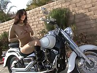 Biker babe pleasures her pussy in boots