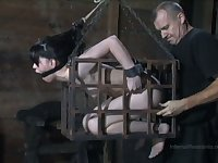 Locked in metal cage submissive whore Felonie gets her mouth stretched
