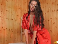 Long haired beauty Jemma exposes her cleverage while wearing red robe