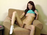 Naughty hairy girl posing solo at home