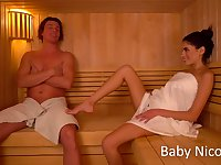 Sexually charged chick Baby Nicols gives a blowjob in sauna and gets fucked on the bed