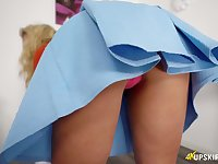Blond wench in short skirt is flashing her tasty looking pussy upskirt