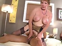 An older woman gets the screwing of her life from a muscled stud
