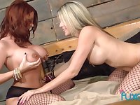 Red haired milf is eager for tasty muff which belongs to blond girlfriend