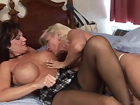 Seductive matures in a sensual lesbian cam play in bed