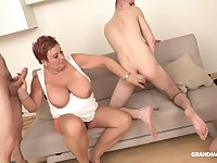 Chubby mature on her knees having sex with a lot of amateur guys