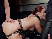 Chained redhead gets anal training