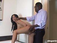 Busty brunette loads the boss's black monster in office XXX scenes