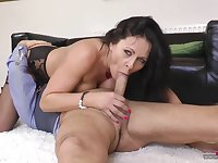 Mature brunette in black stockings and garter belt is fucking an elderly man on the sofa