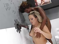 Carmen Valentina and Daizy Cooper are sucking a black cock through a gloryhole, and enjoying it